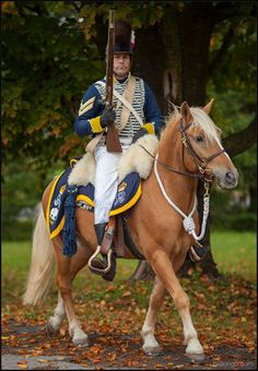 "19 th Regiment of Light Dragoons-COURTESY OF DAN WILLIAMS. Corporal- ""Old pattern uniform worn until 1814-   Three squadrons arrived in Canada in May 1813. In 1813, the 19th still had the old pattern uniform hussar-style uniform with Tarleton helmets."