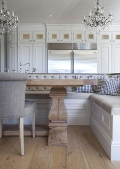 Hayburn & Co beautiful white, sand, and linen color scheme with a lovely banquette backing up to an island.