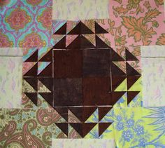 It's called Shimmering Triangles , and it's a pattern available on Craftsy with support from a facebook group called Shimmering Quilts. ...