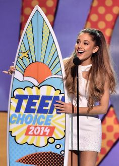 """You love me, you really love me."" Ariana Grande gushes as she accepts the Choice Female Artist award at the 2014 Teen Choice Awards on Aug. 10 in Los Angeles"