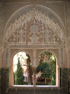 The Alhambra in Granada, Spain - breathtaking carved and ceramic tiled walls and columns.  A magical place that made me think of flying carpets and genies!