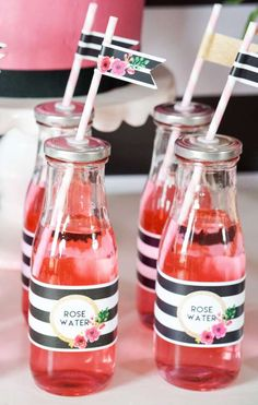 Rose water drinks at a black and white floral birthday party! See more party ideas at CatchMyParty.com!