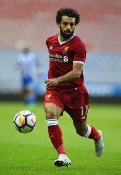 Mohamed Salah Photos Photos - Mohamed Salah of Liverpool during the pre-season friendly match between Wigan Athletic and Liverpool at DW Stadium on July 14, 2017 in Wigan, England. - Wigan Athletic v Liverpool - Pre Season Friendly