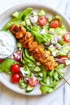 This Mediterranean inspired salad is made with Grilled Chicken Shawarma kebabs served over salad with Feta and Tzatziki. Skinnytaste Recipes, Light Recipes, Meat Recipes, Ketogenic Recipes, Salad Recipes, Low Carb Recipes, Cooking Recipes, Bariatric Recipes, Greek Recipes