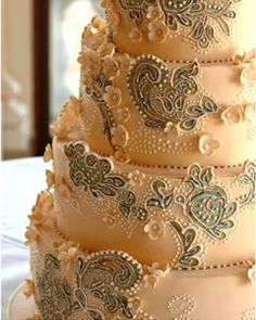 Four tier embroidery wedding cake. The wedding dress cake design based on a couture wedding dress, decorated with an unusual embroidery resembling the bride's dress. From www.idreamofcake.com
