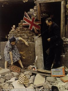 Blitz spirit: A woman rescues board games from the wreckage of her home during the German bombing raids