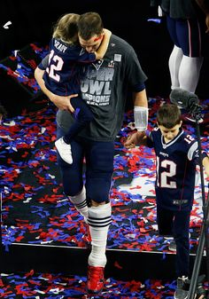 Tom Brady of the New England Patriots celebrates with his kids after defeating the Atlanta Falcons 3428 in overtime during Super Bowl 51 at NRG...