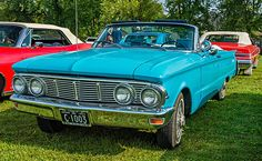 1963 Mercury Comet Convertible.  A restored 1963 Comet convertible at the Bolton Fall Fair. The continental kit adds wonderfully garish length to what would have been a reasonable sized car. A sign of the times when size and chrome ruled.