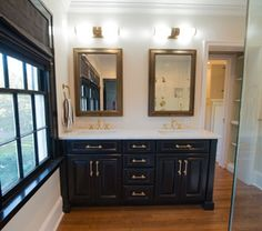 Borders Woodworks 904.524.5204 designed, built, and installed this custom poplar and maple bathroom vanity as part of a home improvement project in a home in the Riverside community here in Jacksonville, Florida.