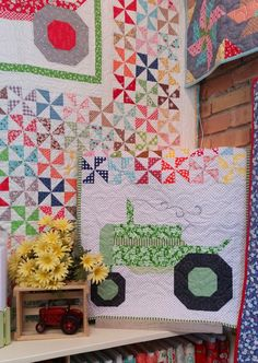 This cute Tractor Table Runner was designed by Thimbles And Threads from Lori Holt's Farm Girl Vintage Book.  We used 2 of Lori's Tractor Blocks and her pinwheels from the Tractor Quilt to make this table runner.  Kit includes all fabrics for the top and
