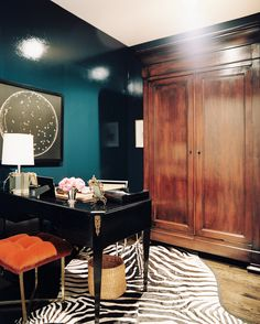 Dark teal walls in home office