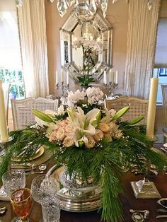 Celebrate the most exciting and cherished holiday of the entire year with Gorgeous Christmas Floral Arrangements that bring nature indoors and set a mood of generosity and appreciation. Christmas Floral Arrangements, Table Arrangements, Christmas Centerpieces, Floral Centerpieces, Table Centerpieces, Flower Arrangements, Christmas Decorations, Holiday Decor, White Centerpiece