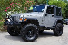 "2000 Silverstone Metallic Jeep Wrangler Sport - 4"" Skyjacker Suspension Lift w/New 33"" Hankook MT Tires, Rugged Ridge Off-Road Lights, Custom Bumper, Smooth Ride! http://www.selectjeeps.com/inventory/view/8355085/2000-Jeep-Wrangler-2dr-Sport-League-City-TX"