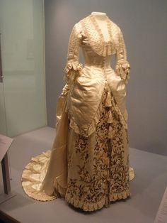 ⓒRebecca Bugge, All Rights Reserved  Do not use without permission.    Evening dress by Frederick Worth, 1881. Silk satin, trimmed with pearl embroidery and machine-made lace, lined with white silk; the bodice supported with whalebone struts. It was ori