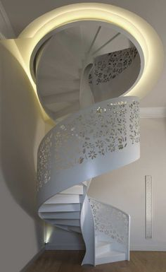 Laser cut panels for spiral staircase for a collector in Florence. Ornamental laser perforation