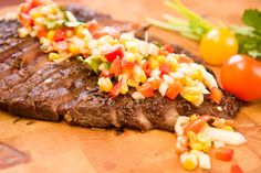 It's come that time again.  You know what I mean. The time when you will do anything to stay out of the kitchen.  So here's a gorgeous flank steak, marinated in Spanish smoked paprika, garlic, and lemon juice, then grilled over hot coals. Serve with an adlib garden relish.