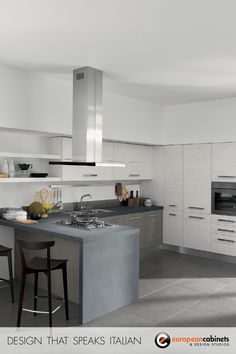 Gray and white kitchen cabinets with a waterfall edge countertop and stainless steel range hood.