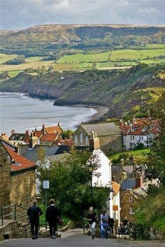 Robin Hood's Bay, Yorkshire, England  This is one lovely town.  Would love to go back for a visit. We stopped on a hill overlooking the town and sat on a bench taking in the beautiful scenery.