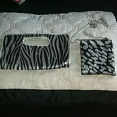 Animal Print Bling Purse Set . Both items . To cute nrw condition both items Black silver metal cross body purse Black silver tiger print hand bad clutch Great for Christmas parties Bags Crossbody Bags