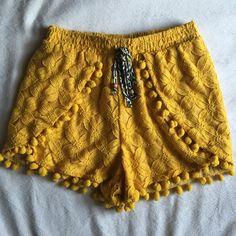 Xhilaration yellow shorts Super cute shorts. I wore them once. They have a small breach stain at the front, not noticeable, but It's there. Xhilaration Shorts