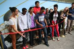 The Ribbon Cutting Ceremony to celebrate the finished mural.