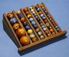 Bennington Clay Marbles displayed on an antique coin tray.