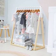 How to create a children's room in Scandinavian style – The Mood Palette Scandinavian living is synonymous to minimalism, functionality and neutral colours. It's one of the most loved modern interior decor trends. While the entire house is getting a moder Baby Room Closet, Baby Bedroom, Girls Bedroom, Baby Clothes Hangers, Diy Clothes Rack, Kids Clothing Rack, Closet Clothing, Clothing Ideas, Montessori Bedroom