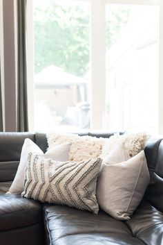 How to Choose the Throw Pillows for a Gray Couch   INTERIORS   home      homegoods throw pillows on  zgallerie leather sectional sofa in family  room   HelloGorgeous