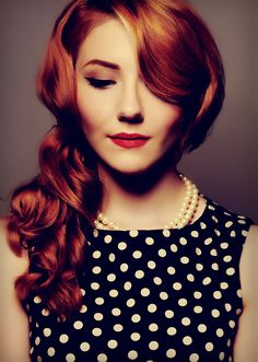 This woman is SO classy....from her pearls to her red lipstick not to mention her soft curls...just lovely...