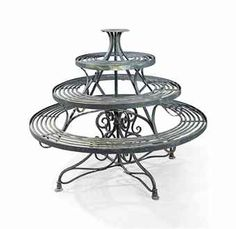 A VICTORIAN PAINTED WROUGHT-IRON REVOLVING PLANT-STAND