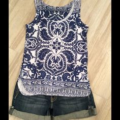 Cute Tank! 💙 FINAL PRICE💙 Waist length with scoop neck. Sleeveless, relaxed style. 95% polyester 5% spandex. No manufacturer tag (shirt came this way). Semi-see through ( may need a tank or bralette). Tops Tank Tops