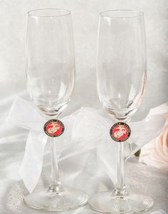 This beautiful wedding toasting glasses set features the Army, Navy, Air Force, or Marine military seals on an organza bow. Glasses made of crystal. Organza bow available in White and Ivory. SEE SEALS UNDER DETAILED IMAGES.<br />