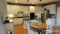 Kitchen redo with white painted cabinets and tile backplash   11 Magnolia Lane