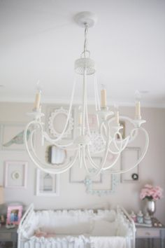 Gold chandelier from Home Depot, repainted with White Chalkpaint and strung with sentimental string of pearls. Super-sweet DIY!