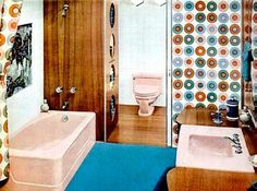 1960s: Bathroom with wood panels and flooring and pale pink suite.
