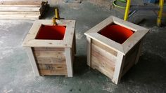 5 gallon bucket planters made of pallet wood and Home Depot buckets.