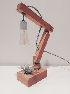 Hand-made oak articulating desk lamp with airplant and Edison bulb. #portfolio #woodworking #moderndesign