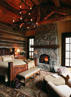 lodge bedroom with stone fireplace