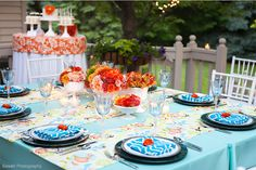 Like the Colors of the Blue and Orange Table Settings and Dessert Table