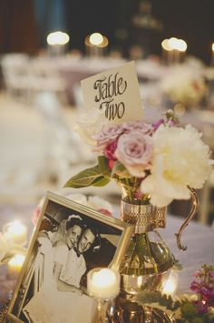 love the use of family wedding photo's incorporated into the centerpieces