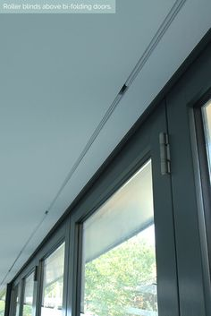 Concealed roller blinds above bi-folding doors. #Shades #Hidden #Lutron #Blindspace
