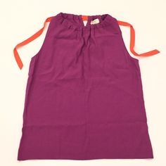 NWOT Kate Spade 'Selena' Sleeveless Shirt Kate Spade 'Selena' Sleeveless Shirt. Color: Baja Rose; Orange tie. Size Small. Slight boatneck cut across the shoulders and loose tunic fit, also boasts hidden bra strap holders on the inside to keep your intimates perfectly in place. 23.25 inches from shoulder to hem, 17inches from armpit to armpit. Excellent condition; never worn. kate spade Tops Blouses