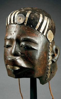 Africa | Helmet mask from the Makonde people of Tanzania/Mozambique | Wood, metal, shell, animal hide