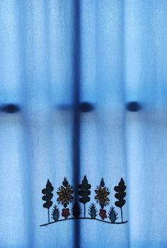 Hand-embroidered curtain with traditional pattern