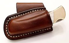 nice neat knife sheath i will hopefully be getting into some leather work this year