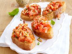 It's officially tomato season! Celebrate the summer and its bounty with this simple crowd pleasing recipe! Tomato Bruschetta, Bruschetta Recipe, Party Finger Foods, Snacks Für Party, Crostini, Canapes, Tomato Season, Vegan Recipes, Food Porn
