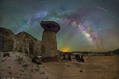 Toadstool rocks, in Page, Arizona, are perfectly framed by the Milky Way and a golden glow...