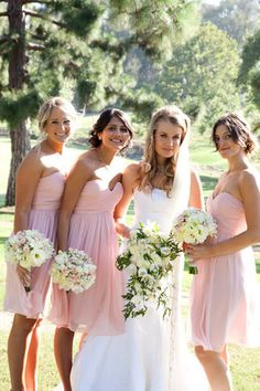 I like the idea of soft pink bridesmaid dresses with the green wedding theme- looks good with green and white flowers!