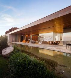 Casa MS by Studio Arthur Casas features both opaque and transparent facades