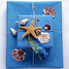 Gift Wrapping | Carolyne Roehm!!! Bebe'!!! Love the sea shells and star fish!!!